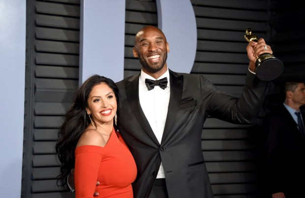 "Vanessa Bryant, left, and Kobe Bryant, winner of the award for best animated short for ""Dear Basketball"", arrive at the Vanity Fair Oscar Party on Sunday, March 4, 2018, in Beverly Hills, Calif. (Photo by Evan Agostini/Invision/AP)"