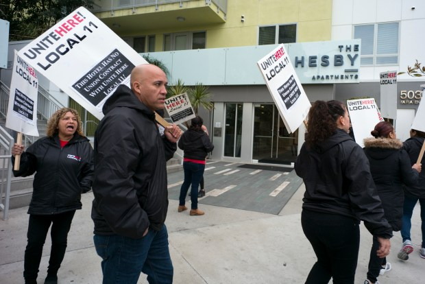 "United Local 11 workers and representatives chant in the early morning on March 7 2018, outside of The Hesby Apartments in North Hollywood Wednesday. The protest was part of a coalition of housing rights activists and hotel workers conducting a week of action at six locations where the activists claim Airbnb has effectively turned residential housing into ""bootleg hotels."" (Photo by David Crane, Los Angeles Daily News/SCNG)"