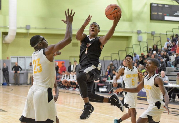 Van Nuys High's Tyree Winborn (1) scores in he first quaerter during the L.A. City Section boys basketball Division II Final between Van Nuys High and King/Drew High at Roybal Learning Center in Los Angeles on Friday, March 2, 2018. (Photo by Dan Watson / SCNG)