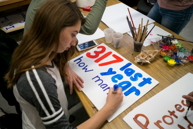 Hailee Kessler and other students at Daniel Pearl Magnet High School in Van Nuys prepare signs for a walk-out Wednesday to commemorate the school shooting in Parkland Florida. Students across the country plan a walk-out tomorrow to commemorate the shootings and protest current gun laws. (Photo by David Crane, Los Angeles Daily News/SCNG)