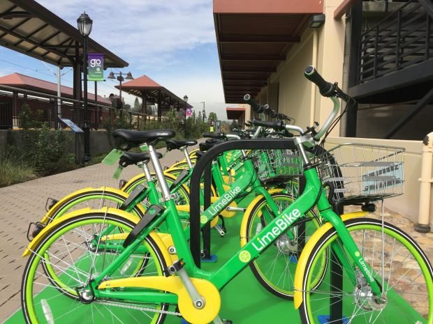 Twenty dockless LimeBikes have been parked here in existing bike racks at the Monrovia Gold Line Station on Tuesday, March 20, 2018. The city sees the bikes as a way for train passengers to connect to and from the station and Monrovia offices, eateries or residences. (Photo by Steve Scauzillo, Pasadena Star-News/SCNG)