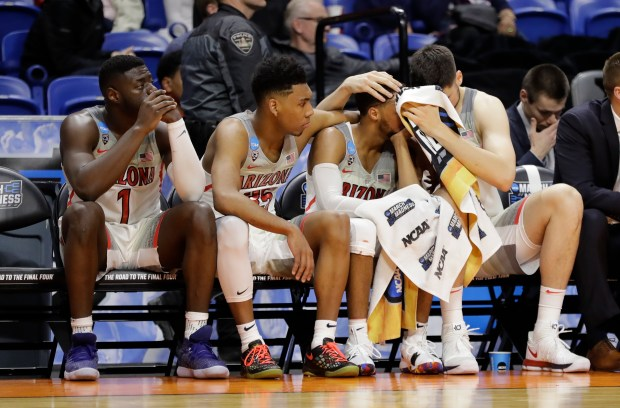 Players on the Arizona bench react during the second half of a first-round game against Buffalo in the NCAA men's college basketball tournament Thursday, March 15, 2018, in Boise, Idaho. Buffalo won 89-68. (AP Photo/Otto Kitsinger)