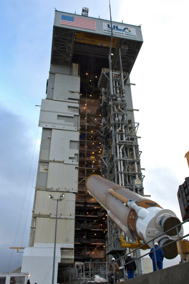 A crane lifts a Atlas V booster at Vandenberg Air Force Base. Liftoff is scheduled for May 5, 2018. (Credit: NASA/Randy Beaudoin)
