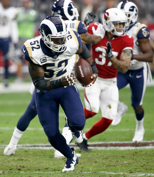 In this Dec. 3, 2017, file photo, Rams inside linebacker Alec Ogletree (52) returns an interception for a touchdown during the first half of an NFL football game against the Arizona Cardinals in Glendale, Ariz. The Rams have agreed to trade linebacker Alec Ogletree to the New York Giants for two draft picks. (AP Photo/Ross D. Franklin, File)