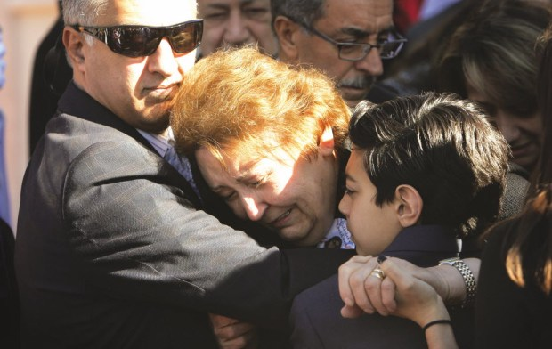 Arlen Verdehyou, left, and his son Colin, console Shemiran Betbadal, mother of Bennetta Betbadal at the end of her service on Monday, Dec. 14, 2015 at Sacred Heart Catholic Church in Rancho Cucamonga. Betbadal was one of the 14 victims of the Dec. 2 San Bernardino massacre. Arlen is the husband of Bennetta and Colin is their son. On Saturday, March 10, a healing garden is being planted in Bennetta's honor at a park in Norco. (File photo by Stan Lim, The Press-Enterprise/SCNG)