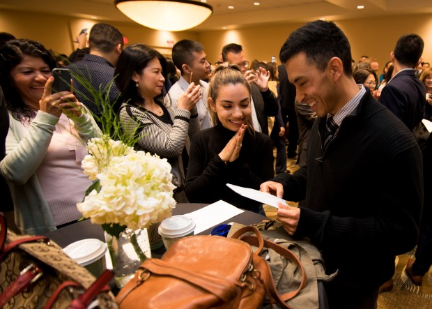 Liz Fernandez waits in anticipation as fiancée Chad Correa opens his Match Day letter. Forty-nine fourth-year students in the UC Riverside School of Medicine took part in Match Day on Friday, March 16.Photo by Frank Perez, contributing photographer