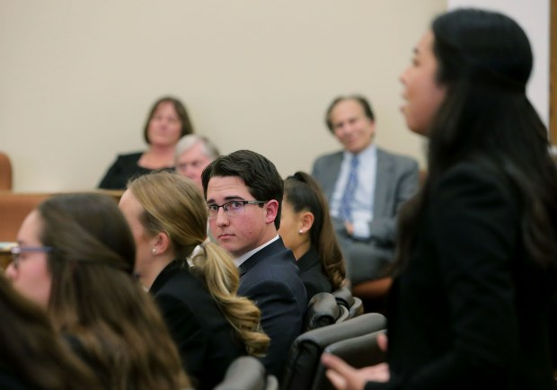 King's Daniel Sosa, left, won a statewide award for outstanding defense attorney. He's shown here acting as a prosecutor, listening to defense attorney Rachael Heil of Poly High during the finals of the 35th annual Riverside County Mock Trial Competition at Riverside Historic Courthouse Saturday in Riverside, CA. March 3, 2018. (TERRY PIERSON,THE PRESS-ENTERPRISE/SCNG)