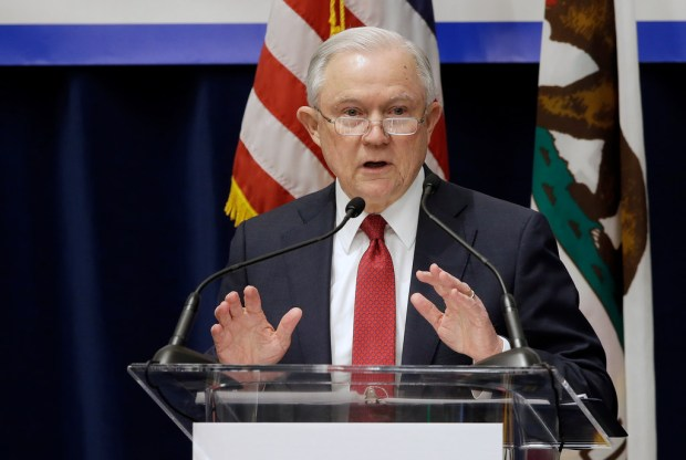 U.S. Attorney General Jeff Sessions addresses the a gathering of the California Peace Officers' Association in this March 7 file photo. The Trump administration has sued to block California laws that extend protections to people living in the U.S. illegally. (AP Photo/Rich Pedroncelli)