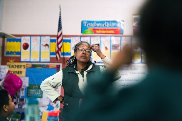 Monique Brandon teaches her third grade class on Tuesday, March 13, 2018, in a classroom where the air is filtered at Resurrection Elementary School in Los Angeles. AQMD says indoor air pollution could be hazardous to the students' health and is spending $250,000 on air filters for the school. (Photo by Sarah Reingewirtz, Pasadena Star-News/SCNG)
