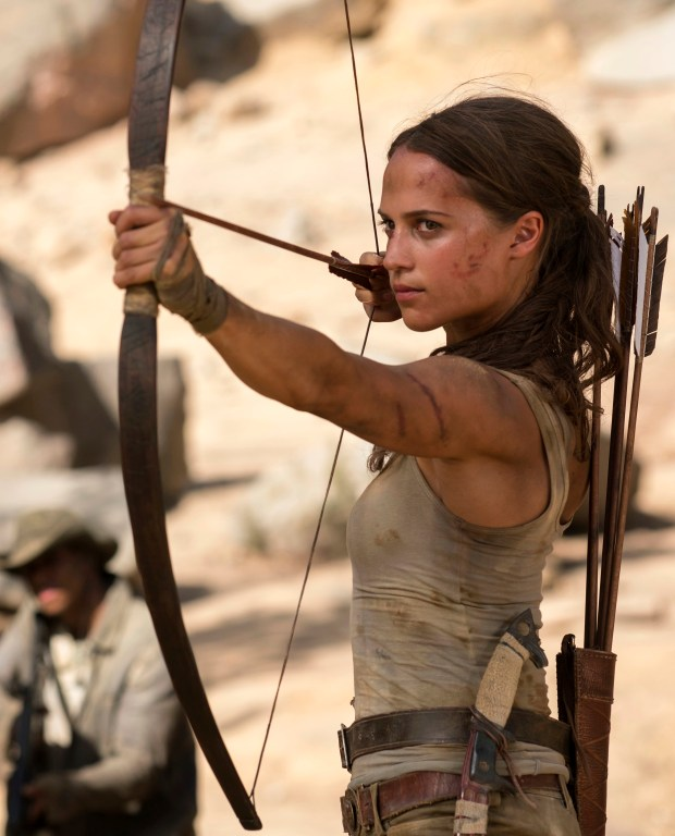 "This image released by Warner Bros. Pictures shows Alicia Vikander in a scene from ""Tomb Raider."" It took weeks of training and plates full of protein to turn former ballerina Alicia Vikander into action star Lara Croft. (Ilze Kitshoff/Warner Bros. Pictures via AP)"