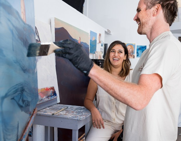 Negah Nafisi, left, the founder of Easel, shares a laugh with artist Shane McClatchey at his studio space in Laguna Beach.