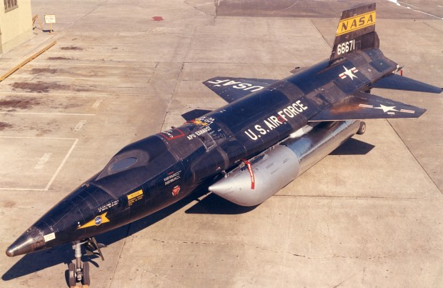 """The X-15 experimental jet aircraft at Edwards Air Force Base, the later version with the """"hot cone."""" Undated photo, post-1961. (Credit: NASA)"""