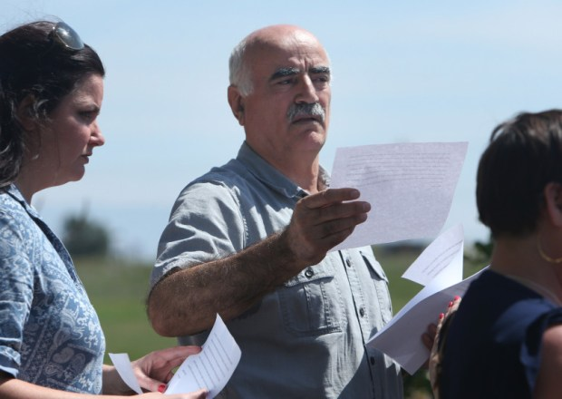 Ismail Aghdam hands out a statement to waiting media outside his Menifee home on Wednesday, April 4, 2018. Ismail's daughter, Nasim Aghdam was the allege shooter at the YouTube headquarters in San Bruno yesterday.(Stan Lim, The Press-Enterprise/SCNG)