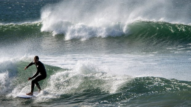 A surfer rides a wave at Bolsa Chica State Beach in Huntington Beach, in winter, 2016. (File photo by Jeff Gritchen, Orange County Register/SCNG)