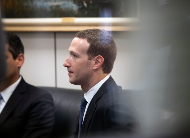 Facebook CEO Mark Zuckerberg sits in a waiting room before meeting with Sen. Bill Nelson, D-Fla., the ranking member of the Senate Commerce Committee, Capitol Hill in Washington, Monday, April 9, 2018. Zuckerberg will testify Tuesday before a joint hearing of the Commerce and Judiciary Committees about the use of Facebook data to target American voters in the 2016 election. (AP Photo/J. Scott Applewhite)