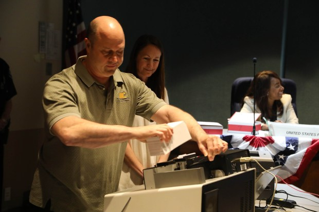 Ballots are counted by Eric Gramm Tuesday night April 10, 2018 at the Palos Verdes Estates City Hall. Photo By Charles Bennett
