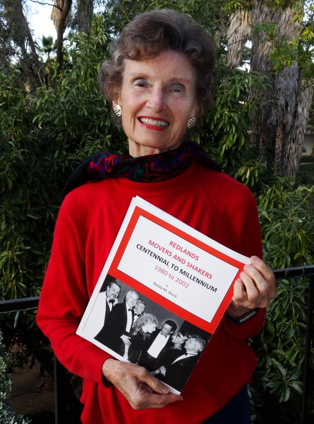 """Nelda Stuck with her new book, """"Redlands Movers and Shakers, Centennial to Millennium, 1980 to 2002"""" (Courtesy Photo)"""