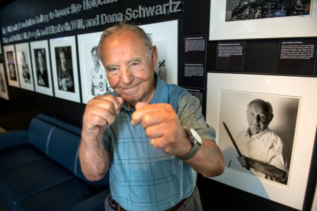 Holocaust survivor Albert (Alberto) Rosa, 93, of Encino, a  former professional boxer, shows his moves by a portrait photograph of himself on display at Los Angeles Museum of the Holocaust in Los Angeles. (2017 photo by Ed Crisostomo, Los Angeles Daily News/SCNG)