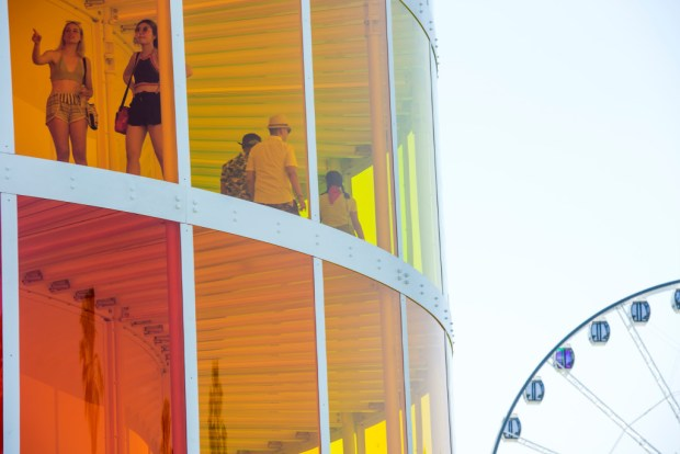 "People walk through ""Spectra"" during the first day of the Coachella Valley Music and Arts Festival at the Empire Polo Club in Indio on April 13, 2018. (Photo by Matt Masin, Contributing Photographer)"