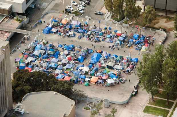 In November, 2017 the Plaza of Flags was full of homeless at the Civic Center in Santa Ana. (Photo by Ken Steinhardt, Orange County Register/SCNG)