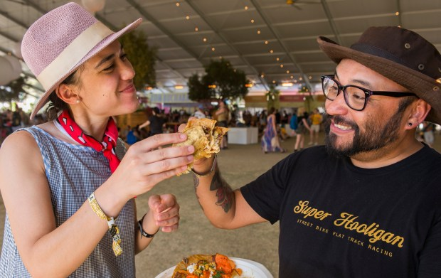 Samantha Melbourneweaver and Richard Guzman taste test the taco's at Coachella Valley Music and Arts Festival in Indio Saturday, April 21, 2018. (Photo by Thomas R. Cordova/Daily Breeze)