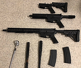 Guns and ammunition were among the items seized, along with a