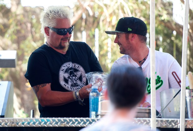 Guy Fieri stops by the kitchen at his eponymous Stagecoach Smokehouse at the Stagecoach Country Music Festival at the Empire Polo Club in Indio on Friday, April 27, 2018. (Photo by Matt Masin, Contributing Photographer)