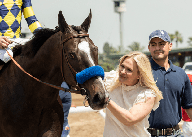 Jill Baffert greets Dr. Dorr after his victory Saturday in the Grade II Californian Stakes at Santa Anita. (Benoit Photo)
