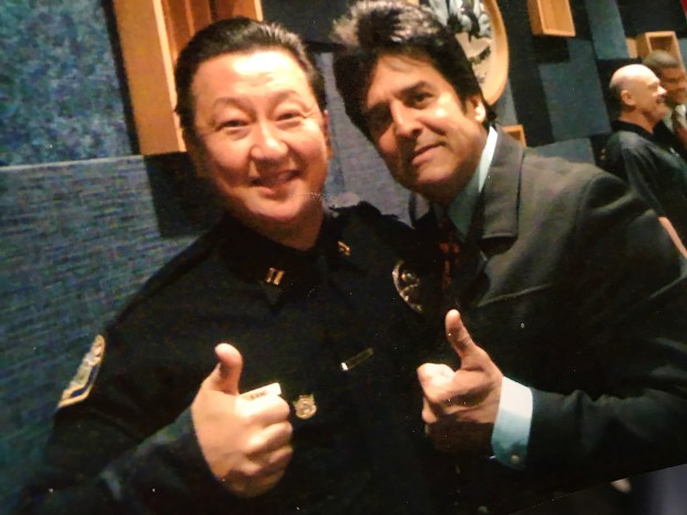 Thomas Kang, new chief of police for the Gardena Police Department, poses for a photo with CHiPs actor Erik Estrada during an awards ceremony in Bellflower in 2014. (Courtesy of Thomas Kang)