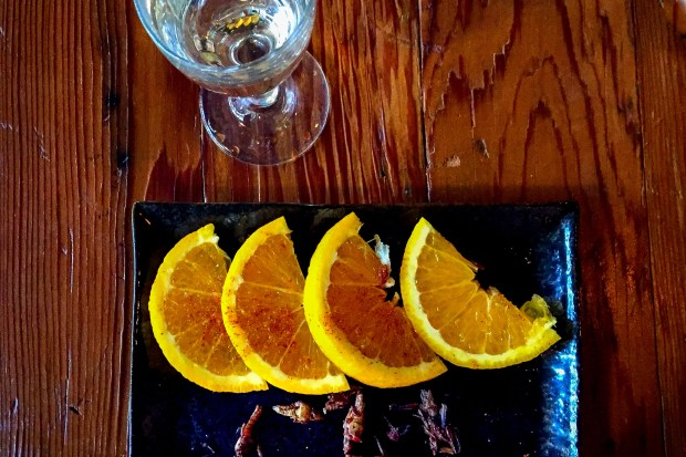 Mezcal straight up, with oranges and crickets, at Urbana in Anaheim. (Photo by Brad A. Johnson, Orange County Register/SCNG)