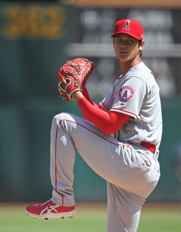 Los Angeles Angels' Shohei Ohtani works against the Oakland Athletics during the first inning of a baseball game on Sunday, April 1, 2018 in Oakland, Calif. (AP Photo/Ben Margot)