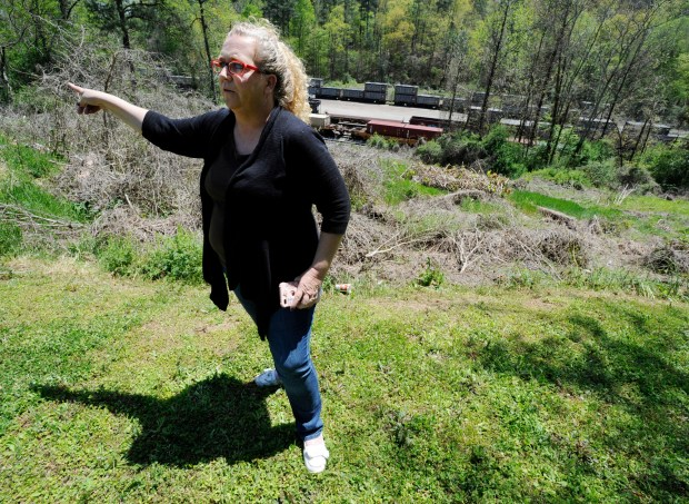"In this April 12, 2018 photo, Mayor Heather Hall discusses the nearby train that was loaded with tons of sewage sludge that is stinking up her community of Parrish, Ala. More than two months after the so-called ""Poop Train"" rolled in from New York City, Hall says her small town smells like rotting corpses. Some say the trainloads of New Yorkers' excrement is turning Alabama into a dumping ground for other states' waste. (AP Photo/Jay Reeves)"