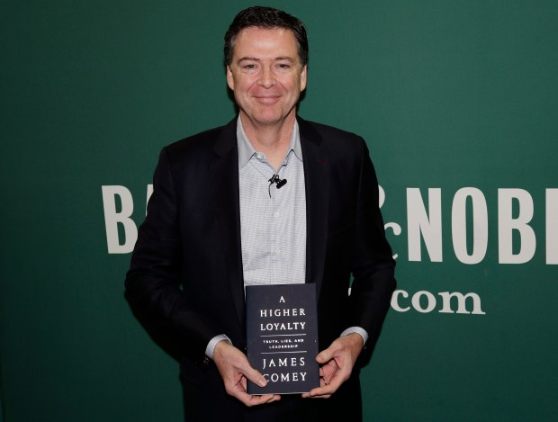 Former FBI director James Comey poses for photographs at a Barnes & Noble before speaking Wednesday, April 18, 2018, in New York. (AP Photo/Frank Franklin II)