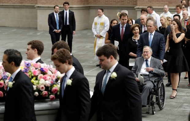 Former President George H.W. Bush and George W. Bush, followed by former first lady Laura Bush follow as pallbearers carry the casket of former first lady Barbara Bush after a funeral service at St. Martin's Episcopal Church, Saturday, April 21, 2018, in Houston. (AP Photo/Evan Vucci)