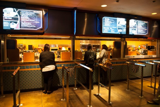 "Members of the media order food at the Galactic Grill during the Disneyland preview of the ""Season of the Force"" Thursday night. ///ADDITIONAL INFO: disney.seasonofforcepreview.kjs --- Photo by KEVIN SULLIVAN / Orange County Register -- 11/12/15 Disneyland will be previewing its ""Season of the Force"" new attractions and shows in Tomorrowland for the media. There will also be more opportunities for photos of parade and fireworks show. 11/12/15"
