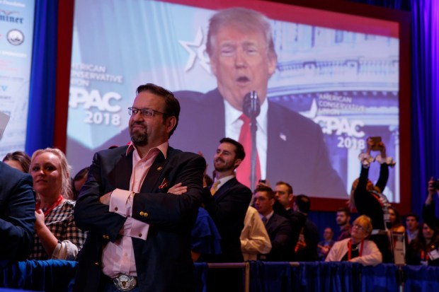 Former White House adviser Sebastian Gorka looks on as President Donald Trump delivers remarks to the Conservative Political Action Conference, Friday, Feb. 23, 2018, in Oxon Hill, Md. (AP Photo/Evan Vucci)