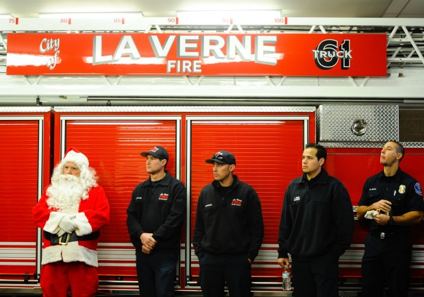 La Verne Fire Department holds its 90th annual Christmas Day program in La Verne, CA on Friday, Dec. 25, 2015. LVFD is the only fire department in the state that features firefighters and engine companies carrying Santa Clause, going through the neighborhood streets to give out a Christmas goodie bag to children, adults and senior citizens in the city. (Photo by Rachel Luna/Inland Valley Daily Bulletin)