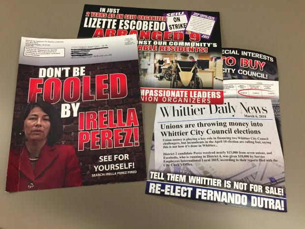Several campaign fliers attacking Whittier City Council candidates Lizette Escobedo and Irella Perez have been mailed to voters. Staff photo by Mike Sprague/Whittier Daily News