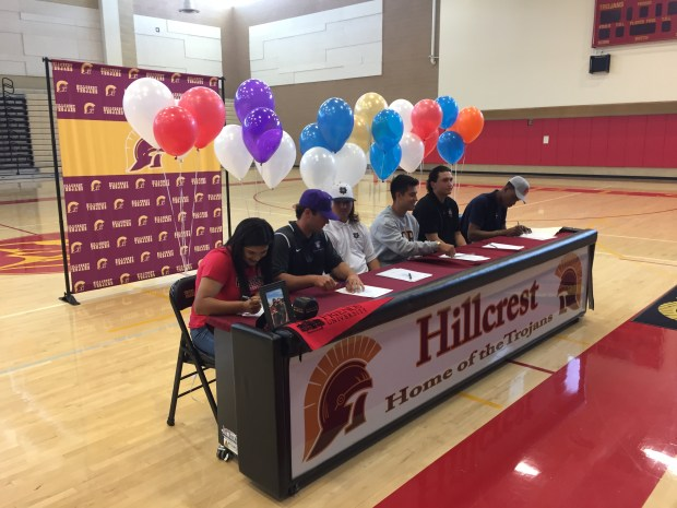 Hillcrest athlete (from L-R) Bobbie Flores, Jacob Higgins, Cade Corsett, Daniel Castaneda, Patrick MacDonald and Victor Ohia Obioha sign national letters of intent Wednesday afternoon. (Photo courtesy of Jackson Wood)