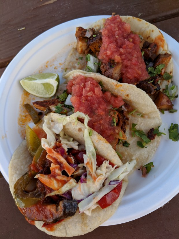 Veggie, al pastor and chicken tacos from Pinches Tacos.