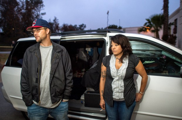 Adam Halvorsen, 39-years old, and girlfriend Angela Del Castillo, 42-years old, next to their van at the West LA Veterans Affairs campus safe parking lot. The pair have been living in the vehicle for a year. (Photo by Hans Gutknecht, Los Angeles Daily News/SCNG)