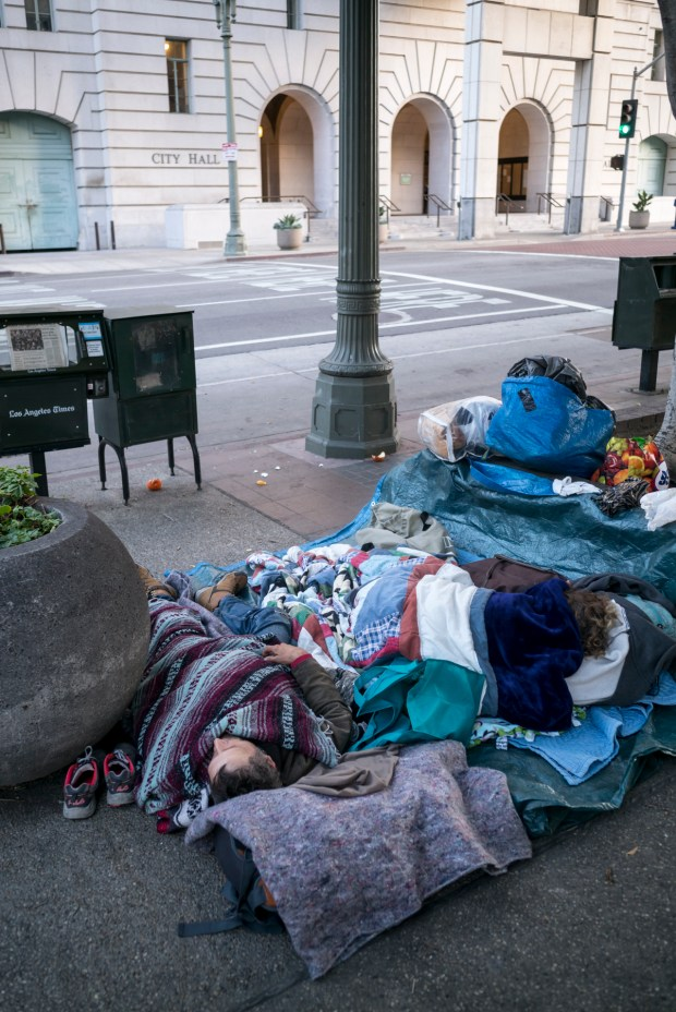 On the morning of the State of the City address presented by Mayor Eric Garcetti at Los Angeles City Hall, homeless begin waking up along Main street at adjacent to City Hall. (Photo by David Crane, Los Angeles Daily News/SCNG)