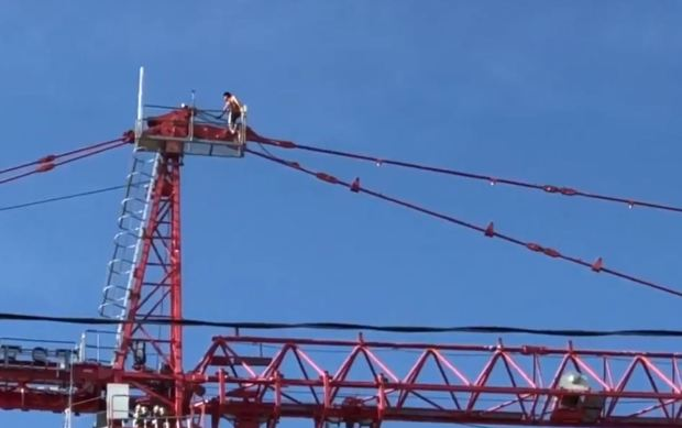 Twitter user @DjDemond_ shared a video of a man on a crane in Hollywood Sunday, April 8. (Image via Twitter)
