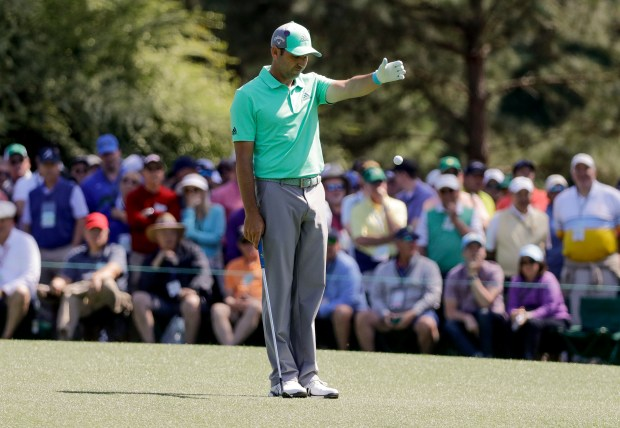 Sergio Garcia, of Spain, takes a drop on the 15th hole during the first round at the Masters golf tournament Thursday, April 5, 2018, in Augusta, Ga. Garcia shot an 8-over 13 on the hole. (AP Photo/David J. Phillip)
