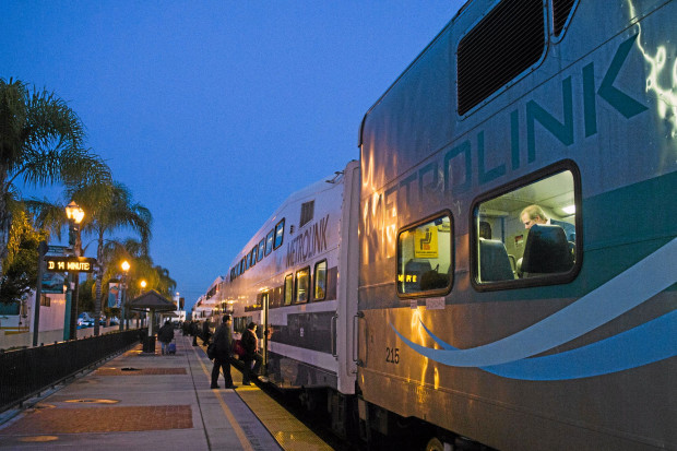 Passengers enter the Metrolink 383 express train from Covina station on early Wednesday morning, March 4, 2014. (Photo by Watchara Phomicinda/ San Gabriel Valley Tribune)