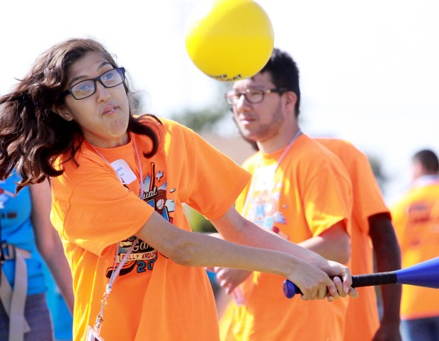 Special-education student Anna Bledsoe-Boger hits the ball during the 2nd Annual Rally Around Fitness event at March Mountain High School in Moreno Valley on Friday, April 13. Photo by Frank Bellino, contributing photographer