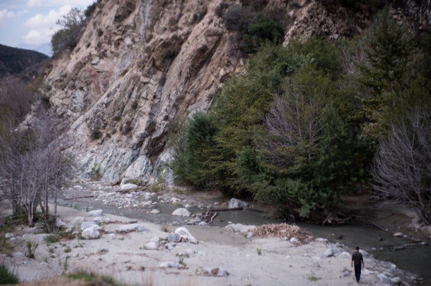 A man walks along the San Gabriel River as government officials, NGOs and volunteers gathered for a one-year anniversary celebration of the San Gabriel Mountains National Monument dedication along the East Fork of the river on Friday, October 16, 2015. (Photo by Sarah Reingewirtz/Pasadena Star-News)