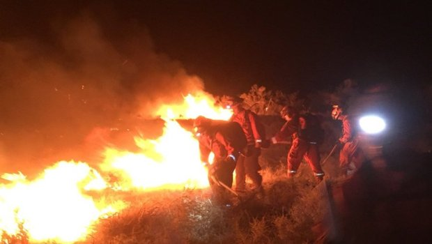 Firefighters work to put out the Moffat fire burning north of Lone Pine in Inyo County. (Courtesy of Cal Fire San Bernardino Unit)