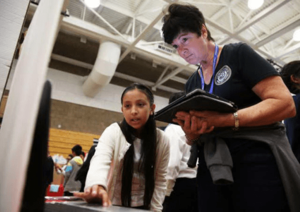 "FILE PHOTO. Samantha Olaguez presents her website she created for her prototype, ""H20 Saver,"" to Temple City Unified Superintendent, Kathryn Perini, during the Invention Convention at Jefferson Middle School in San Gabriel, Calif. on Saturday, May 7, 2016. The students created inventions meant to solve every day problems like cleaning, organization and home security. (Correspondent photo by Trevor Stamp)"