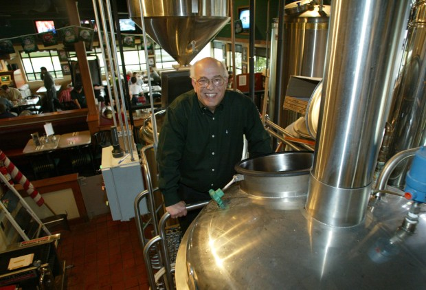 George Hadjas, a co-founder of Oggi's Pizza & Brewing Co., at the brewing room at the Mission Viejo restaurant. (Paul Bersebach, Orange County Register)